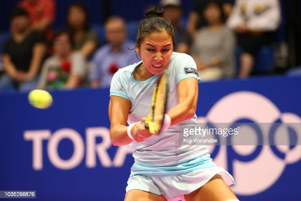 Zarina Diyas of Kazakhstan plays a backhand during her Singles first round match against Barbora Strycova of the Czech Republic on day two of the...