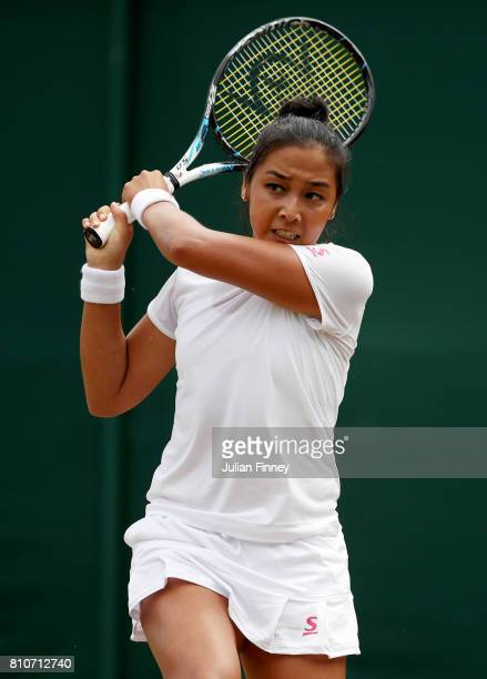 Zarina Diyas of Kazakhstan plays a backhand during the Ladies Singles third round match against Petra Martic of Croatia on day six of the Wimbledon...