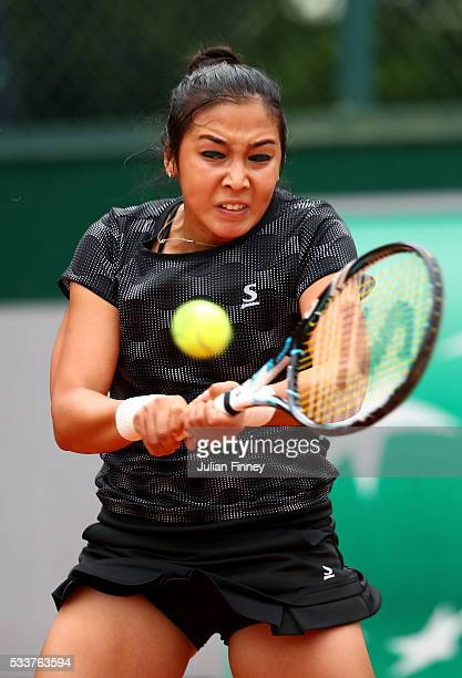 Zarina Diyas of Kazakhstan plays a backhand during the Women's Singles first round match against Carina Witthoeft of Germany on day two of the 2016...