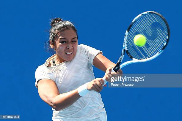 Zarina Diyas of Kazakhstan plays a backhand in her second round match against Anna Schmiedlova of Slovakia during day three of the 2015 Australian...