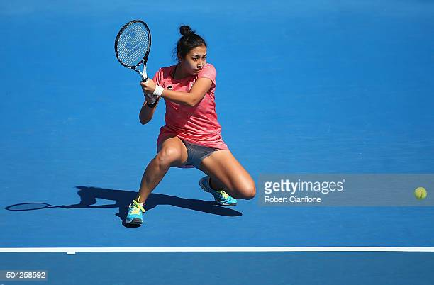 Zarina Diyas of Kazakhstan plays a backhand in the women's singles match against Camila Giorgi of Italy during day one of 2016 Hobart International...