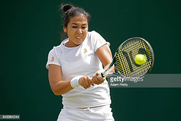 Zarina Diyas of Kazakhstan plays a backhand shot during the Ladies Singles first round match against AnnaLena Friedsam of Germany on day one of the...