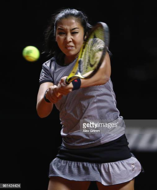 Zarina Diyas of Kazakhstan plays a backhand to Jelena Ostapenko of Latvia during day 4 of the Porsche Tennis Grand Prix at PorscheArena on April 26...