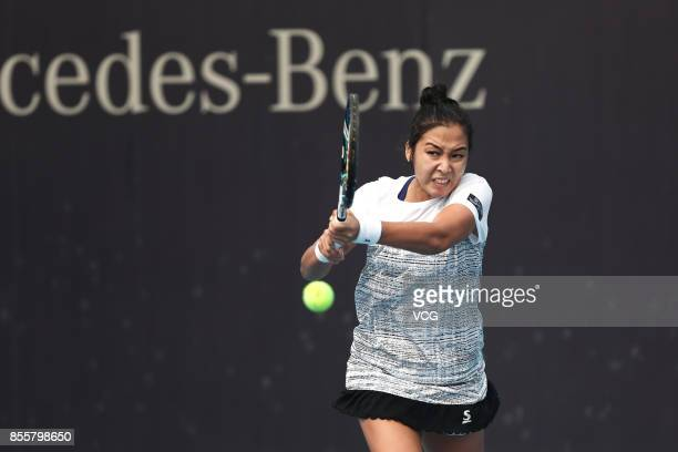 Zarina Diyas of Kazakhstan reacts against Gabriela Dabrowski of Canada during Women's singles qualification match of 2017 China Open at National...