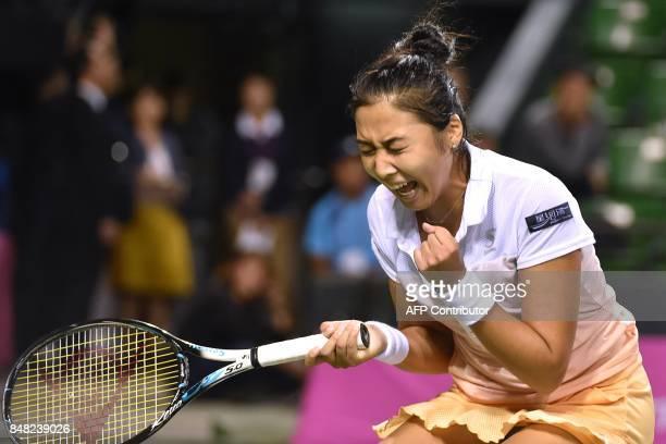 Zarina Diyas of Kazakhstan reacts as she celebrates her win over Japan's Miyu Kato in their women's singles final at the Japan Women's Open tennis...
