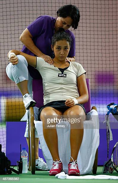 Zarina Diyas of Kazakhstan receives treatment against Monica Puig of Puerto Rico in the rising stars round robin match during previews for the WTA...