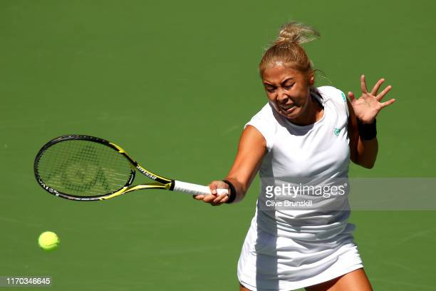 Zarina Diyas of Kazakhstan returns a shot during her women's singles first round match against Ashleigh Barty of Australia during day one of the 2019...