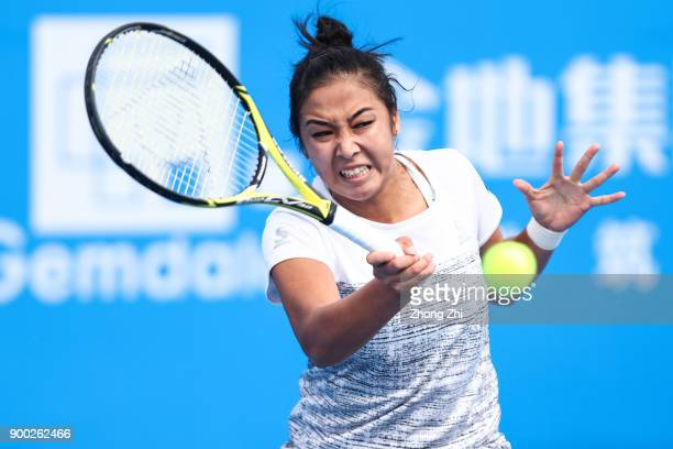 Zarina Diyas of Kazakhstan returns a shot during the match against Pauline Parmentier of France during Day 2 of 2018 WTA Shenzhen Open at Longgang...