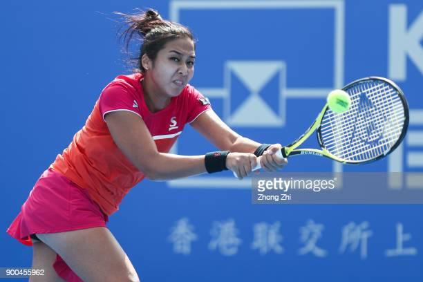Zarina Diyas of Kazakhstan returns a shot during the match against Shuai Zhang of China during Day 3 of 2018 WTA Shenzhen Open at Longgang...