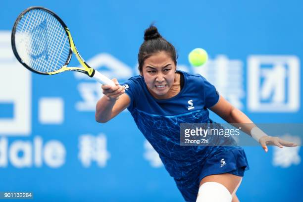 Zarina Diyas of Kazakhstan returns a shot during the match against Maria Sharapova of Russia during Day 5 of 2018 WTA Shenzhen Open at Longgang...