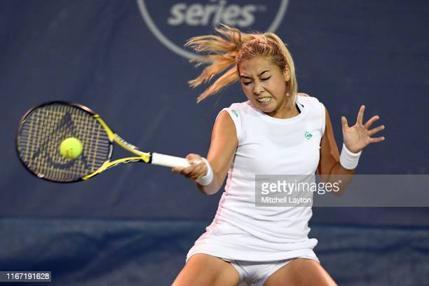 Zarina Diyas of Kazakhstan returns a shot from Camilla Giorgi of France during Day 5 of the Citi Open at Rock Creek Tennis Center on August 2 2019 in...