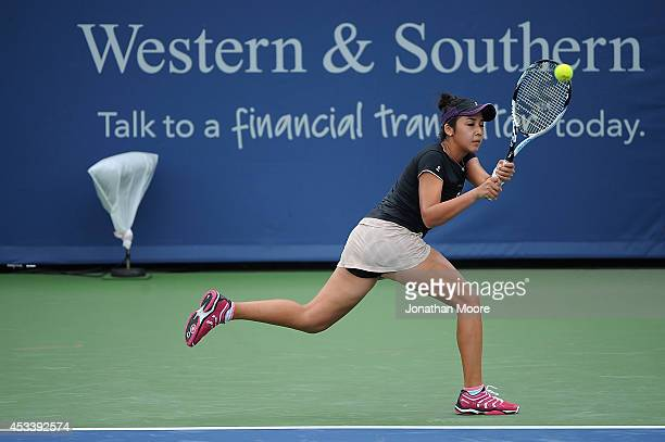Zarina Diyas of Kazakhstan returns to Shelby Rogers during day 1 of the Western and Southern Open on August 9 2014 in Cincinnati Ohio