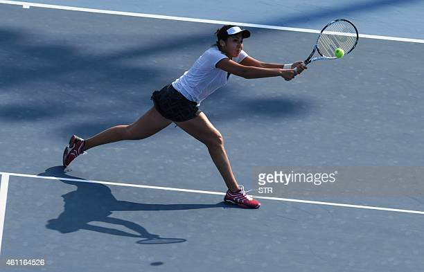 Zarina Diyas of Kazakhstan returns to Zheng Saisai of China during their singles quarter final match at the Shenzhen Open WTA Tennis tournament in...