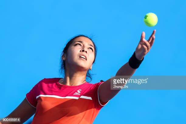 Zarina Diyas of Kazakhstan serves during the match against Shuai Zhang of China during Day 3 of 2018 WTA Shenzhen Open at Longgang International...