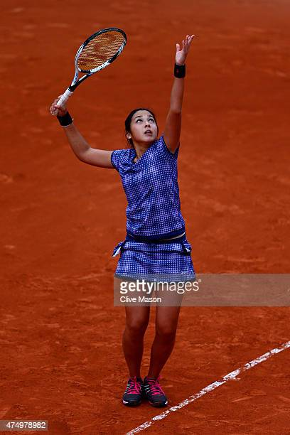 Zarina Diyas of Kazakhstan serves in her Women's Singles match against Alison Van Uytvanck of Belgium on day five of the 2015 French Open at Roland...