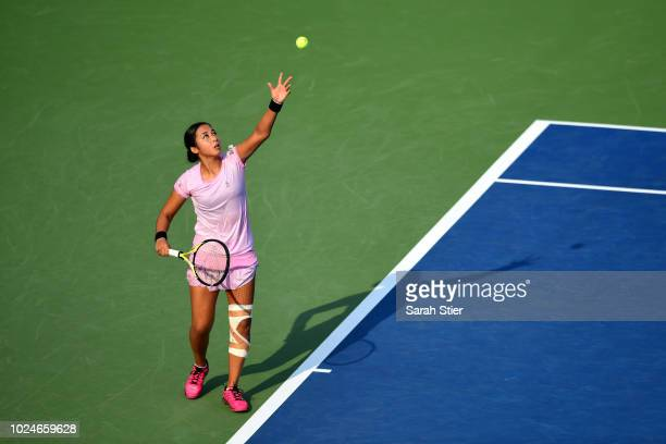 Zarina Diyas of Kazakhstan serves the ball during her women's singles first round match against Kristyna Pliskova of Czech Republic on Day One of the...