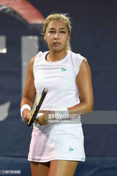 Zarina Diyas of Kazakhstan serves to Camilla Giorgi of France during Day 5 of the Citi Open at Rock Creek Tennis Center on August 2, 2019 in...