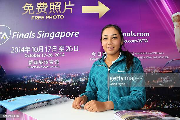 Zarina Diyas of Kazakhstan signs autographs during day two of the China Open at the China National Tennis Center on September 28 2014 in Beijing China