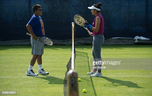 Zarina Diyas of Kazakhstan with her coach during practice on day four of the WTA Aegon Open on June 9 2016 in Nottingham England