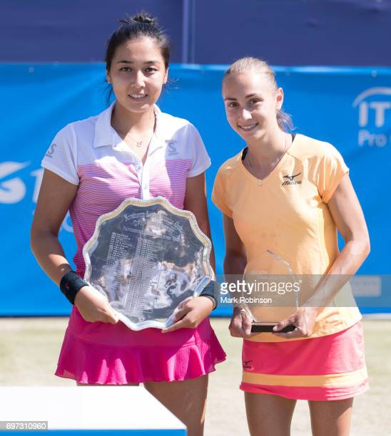 Zarina Diyas of Kazakhstan with her winner's trophy and Aleksandra Krunic of Russia with her runners up trophy after their Women's Final match during...