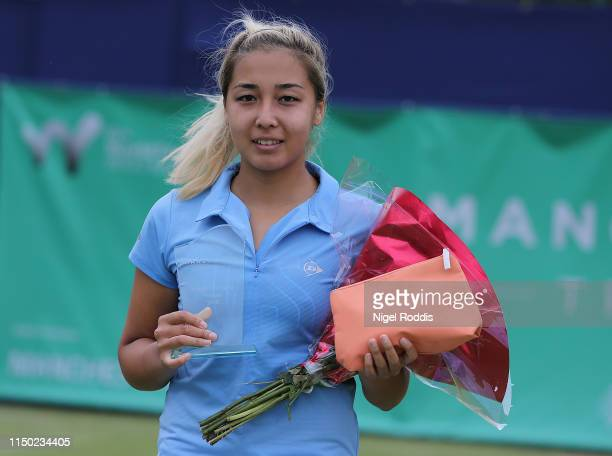 Zarina Diyas of Kazakstan poses for pictures after the Women's singles Final against Magda Linette of Poland of the Manchester Trophy between at The...