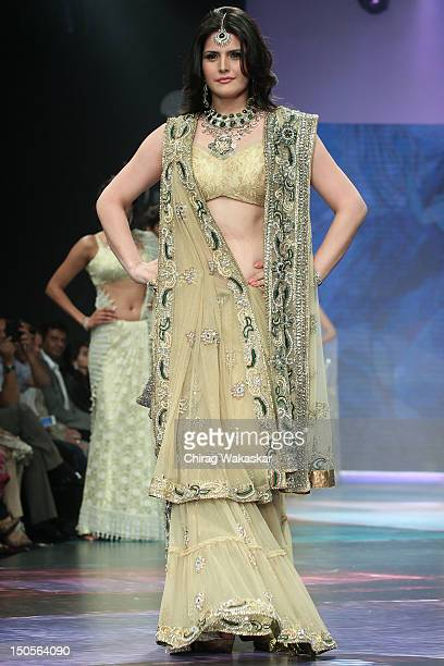 Zarine Khan walks the runway in a YS18 Jewellery design at the India International Jewellery Week 2012 Day 3 at the Grand Hyatt on on August 21 2012...