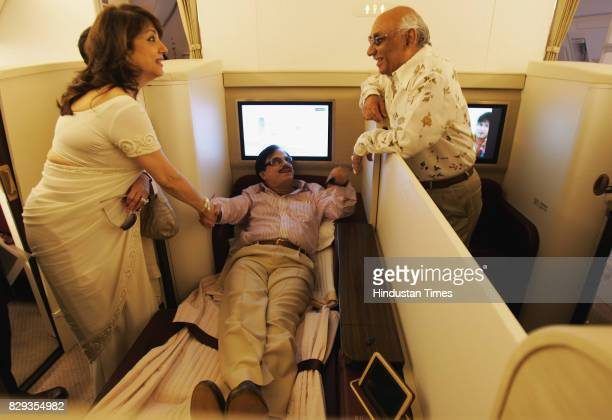 Zarine Khan wife of Sanjay Khan speaks to Yash Chopra inside the First Class section the newly acquired Boeing 777300 ER Jet has purchased these to...