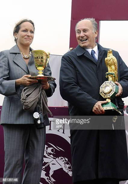 Zarkava's ownerbreeder Karim The Aga Khan and daughter Princess Zahra poses with trophies after threeyearold filly ridden by Belgian jockey...
