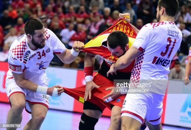 TOPSHOT Zarko Pesevski of Macedonia is fouled by Ilija Brozovic and Luka Sebetic of Croatia during the main round match of the Men's 2016 EHF...