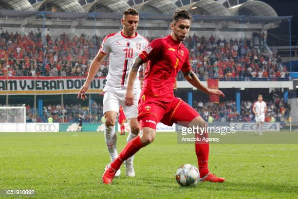 Zarko Tomasevic of Montenegro in action against Dusan Tadic of Serbia during the UEFA Nations League Group 4 of League C soccer match between...