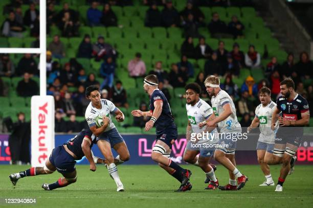 Zarn Sullivan of the Blues gets tackled during round one of the Super Rugby Trans Tasman match between the Melbourne Rebels and Blues at AAMI Park on...