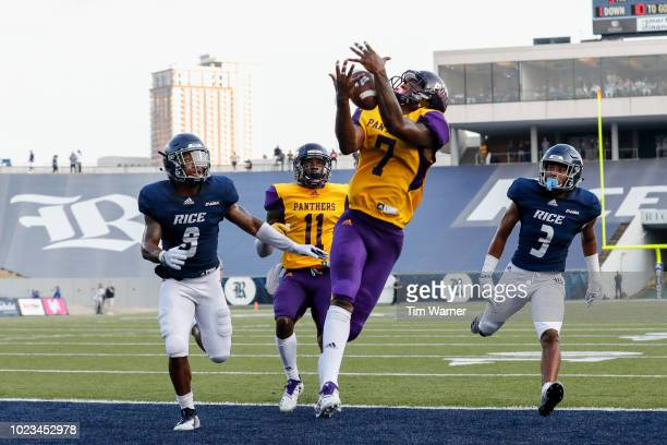 Zarrian Holcombe of the Prairie View AM Panthers catches a pass for a touchdown in the second quarter defended by Jorian Clark of the Rice Owls and...