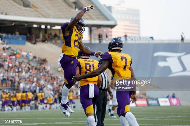 Zarrian Holcombe of the Prairie View AM Panthers is congratulated by Caleb Broach after a touchdown in the first half against the Rice Owls at Rice...