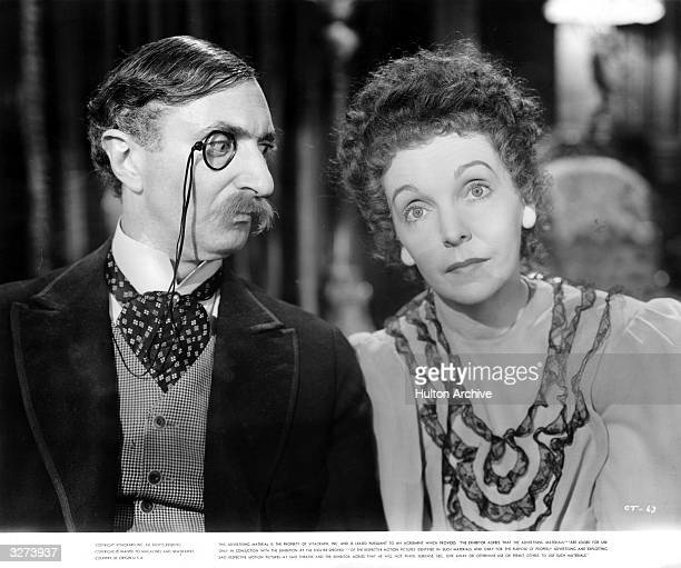 Zasu Pitts , the American actress and Felix Bressart , the German character actor, in a scene from the film 'It All Came True', directed by Lewis...