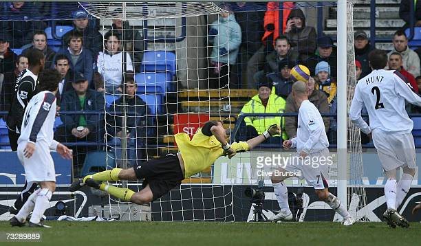 Zat Knight of Fulham scores his team's first goal past the dive of Jussi Jaaskelainen of Bolton Wanderers during the Barclays Premiership match...