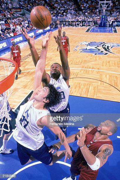 Zaur Pachuila of the Orlando Magic and Alton Ford of the Cleveland Cavaliers battle for the rebound during the 2003 Pro Summer League game at TD...