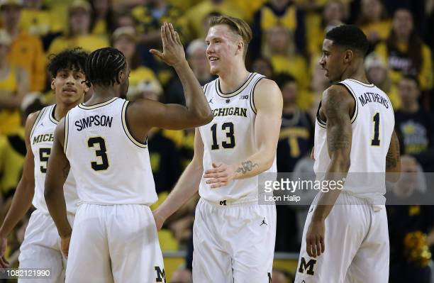 Zavier Simpson and Ignas Brazdeikis of the Michigan Wolverines celebrate a first half basket during the game against the Northwestern Wildcats at...
