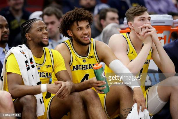 Zavier Simpson, Isaiah Livers, and Colin Castleton of the Michigan Wolverines look on in the second half against the Iowa Hawkeyes during the...