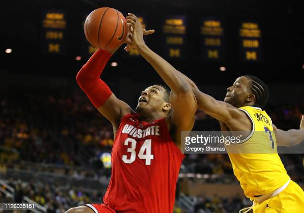 Zavier Simpson of the Michigan Wolverines blocks the shot of Kaleb Wesson of the Ohio State Buckeyes during the second half at Crisler Arena on...