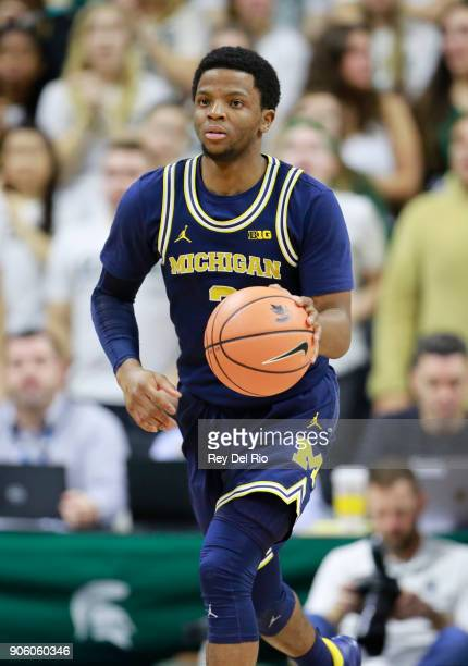 Zavier Simpson of the Michigan Wolverines brings the ball up court during a game against the Michigan State Spartansat Breslin Center on January 13...