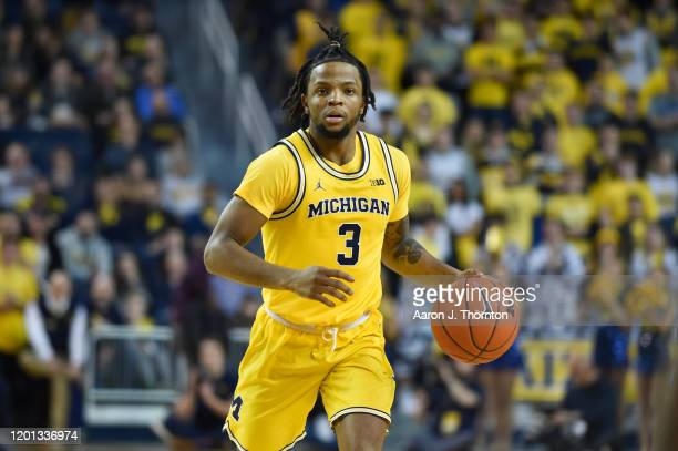 Zavier Simpson of the Michigan Wolverines brings the ball up court during the second half of a college basketball game against the Penn State Nittany...