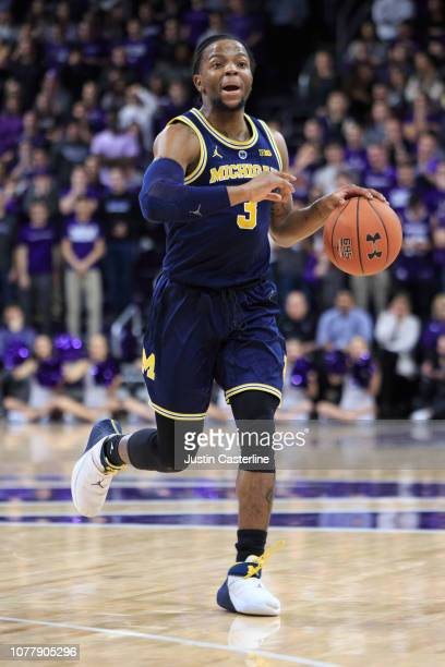 Zavier Simpson of the Michigan Wolverines brings the ball up the court in the game against the Northwestern Wildcats in the first half at WelshRyan...