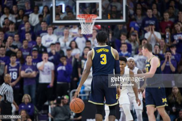 Zavier Simpson of the Michigan Wolverines brings the ball up the court in the game against the Northwestern Wildcats in the second half at WelshRyan...