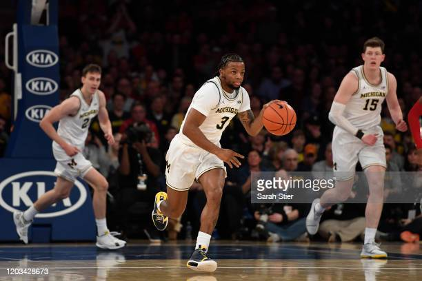Zavier Simpson of the Michigan Wolverines dribbles the ball during the first half against the Rutgers Scarlet Knights at Madison Square Garden on...