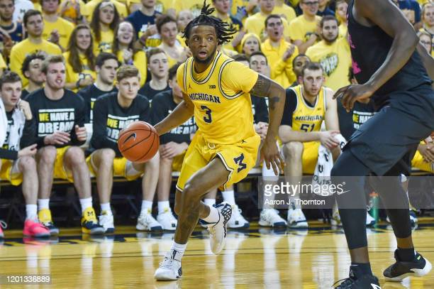 Zavier Simpson of the Michigan Wolverines drives against the Penn State Nittany Lions during the second half of a college basketball game at Crisler...