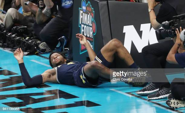 Zavier Simpson of the Michigan Wolverines falls to the floor after getting fouled by the Villanova Wildcats in the second half during the 2018 NCAA...