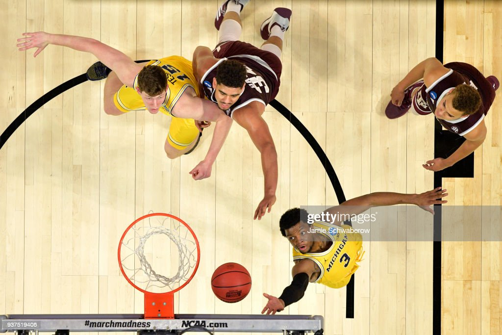 Zavier Simpson #3 of the Michigan Wolverines goes up for the shot in front of Tyler Davis #34 of the Texas A&M Aggies during the third round of the 2018 NCAA Men's Basketball Tournament held at Staples Center on March 22, 2018 in Los Angeles, California.