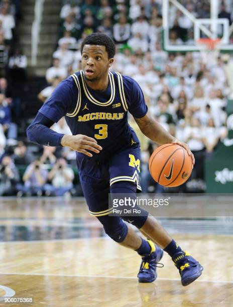 Zavier Simpson of the Michigan Wolverines handles the ball during the game against the Michigan State Spartans at Breslin Center on January 13 2018...