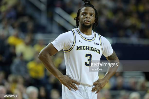 Zavier Simpson of the Michigan Wolverines looks at the scoreboard during the second half of the game against the Illinois Fighting Illini at Crisler...