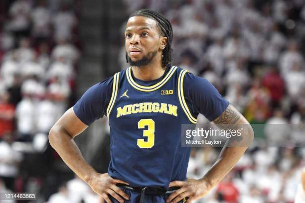 Zavier Simpson of the Michigan Wolverines looks on during a college basketball game against the Maryland Terrapins at the Xfinity Center on March 8,...